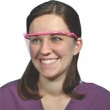 Health care provider wearing PPE eye shields for splash protection.